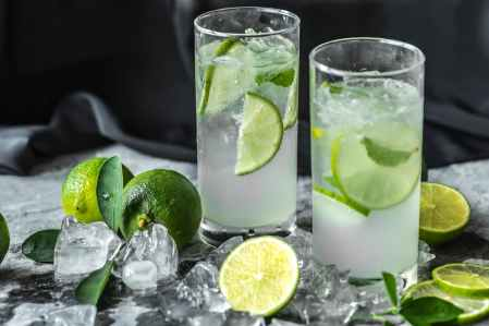 two drinking glass with lime beverages