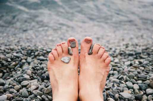 stones on woman s feet